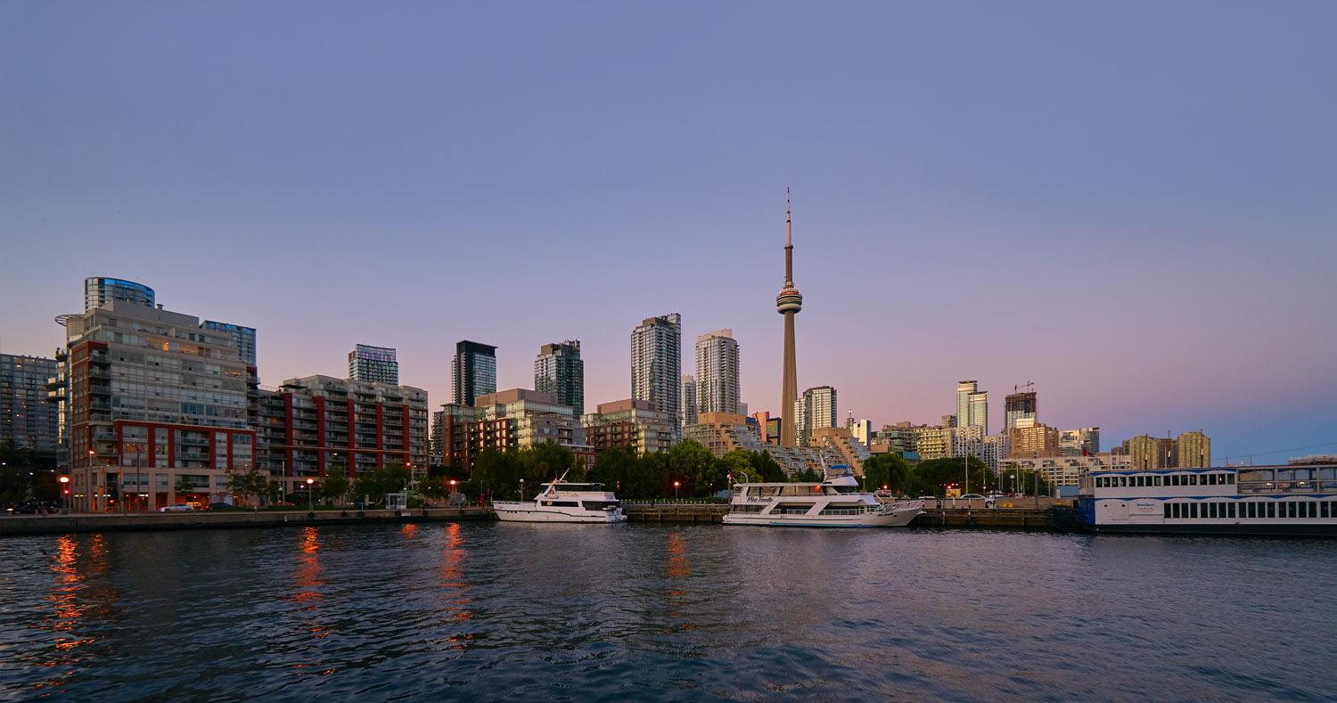 the Toronto city skyline with the lake at sunset